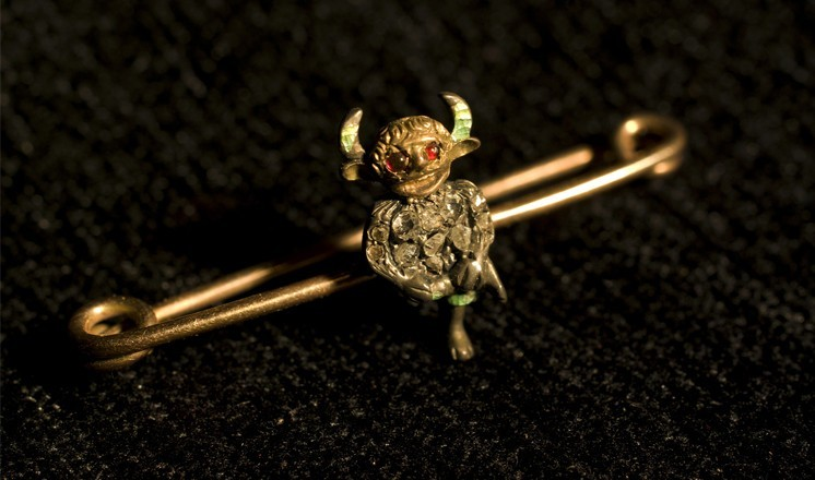 An original Usher imp brooch