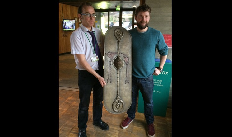 Tom Hughes presenting the shield to The Collection's Dr Erik Grigg