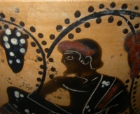 Man and vines on a black figure ware vessel